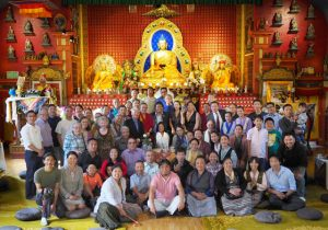 Congresswoman Jayapal with Seattle Tibetan community members, and Sakya Monastery members, in the main shrine hall of the monastery.