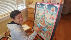 Tibetan thangka painter R.D. Salga is known for his precise hand work, and for his adherence to the rigorous forms of the sacred art form.