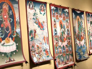 A display of some of Thangka painter Salga's work in the studio at Nalanda West.