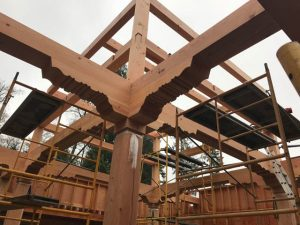 The temple frame shows the traditional Tibetan treatment of the wood structure.
