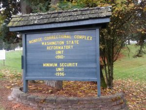The Monroe Correctional Complex sign, at the entrance of Washington State Reformatory (WSR) and the Minimum Security Unit (MSU).