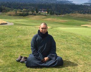 Venerable Xian Zhong from the International Bodhisattva Sangha, meditating at the Newcastle Golf Course near Bellevue, Washington.