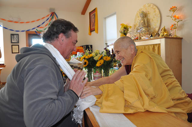 Venerable Thubten Chodron presents Dave Single-Schwall with a ceremonial blessing scarf at her 40th anniversary celebration.