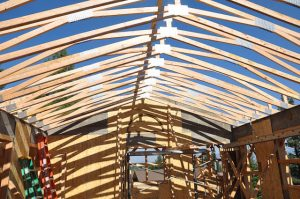 Roofing rafters rise at Prajna Cottage.
