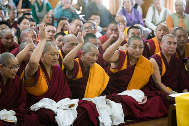 The first geshema nuns, the first to win the equivalent of doctorate degrees, identify themselves during an audience with the Dalai Lama.