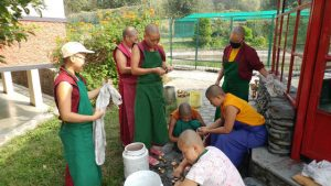Cleaning butter lamps before the ceremonies.