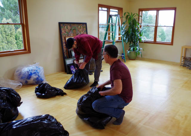 Senior dharma teacher Paul Gulick and dharma teacher Chris Chapman help reassemble the dharma room after the renovations