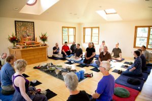 Zen practitioners take part in a formal lunch during a retreat