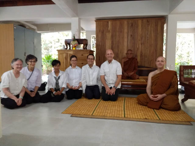 At Wat Na Pa Pong. Left to right: Ruby Grad, Carole Melkonian, Krissy Martin, Joan Benge, Matthew Grad, Scott Benge, Ajahn Liem, Ajahn Sudanto.