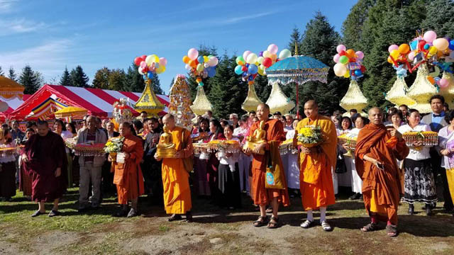 A monk robe-offering ceremony, symbolizing how the community supports monastic life