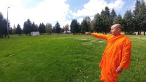 Ven. Aggashri points to where the land will be built