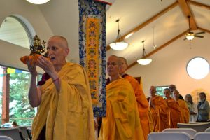 Ven. Thubten Chodron leading a procession of monastics during the 2014 consecration of Chenrezig Hall