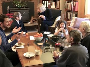 Members gather in the living room for a holiday breakfast