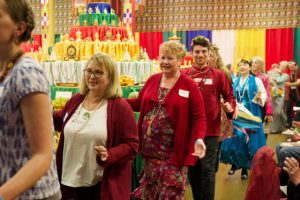 Portland Dharma Center members Kathy Murphy, Karen Michalski and Michael Weingart dance around the Tara mandala
