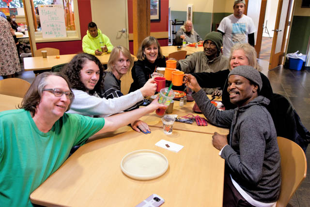 Recovery Café members take a break from their game to cheer recovery!