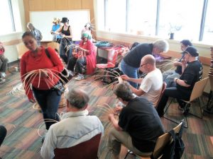 Members engage in basket weaving, a class offered through the School for Recovery.