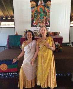 Phyllis Moses, left, and Kim Abbey, right, in front of the altar on the  last day of the Monlam in Brasilia