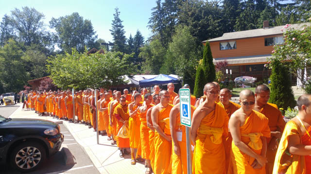 "All 350 monks walked in a procession around Wat Atammayataram, along the monastery's ""Path to the End of Suffering"