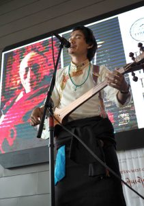Lharik Drakpa, former Tibetan Institute of Performing Artist teacher, sings to the crowd