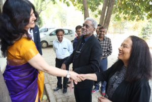 Sharyn Skeeter meeting Sunita Ghosh at Agra University in India, February, 2018. (Charles Johnson is in background.)