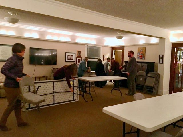 Sangha members pitch in to prepare the Christ Episcopal Church Parish Hall for meditation
