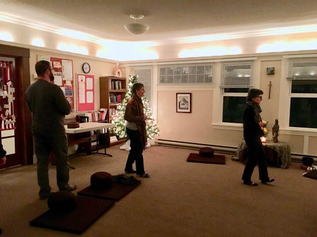 Sangha members practice the slow walking meditation taught by Zen Master Thich Nhat Hanh