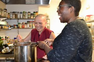 Ven. Thubten Pende and guest Rashika Stephens from Seattle strain chai together