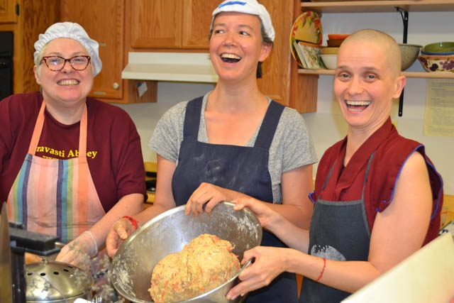 Ven. Thubten Jampa teaches guests Patty Jo Shockley and Fabienne Pradelle to make German bread