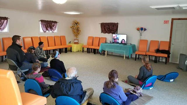 Online and in-person students gather for a dhamma talk and metta
