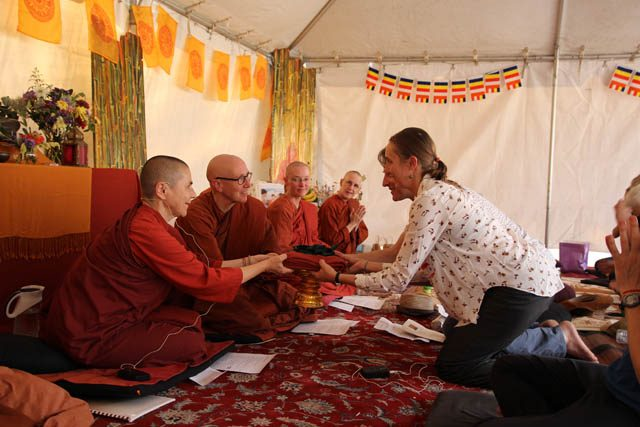 At the heart of the kathina ceremony, Danny Bernstein and Juliann Rhodes offer cloth to Ayya Santacitta and Ayya Anandabodhi, while Dhammadipa Samaneri and Ahimsa Bhikkhuni look on