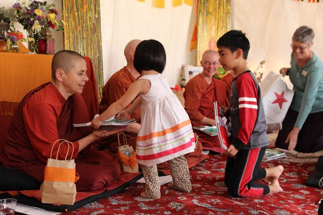 Children give gifts to the Aloka Vihara nuns as part of the kathina ceremony