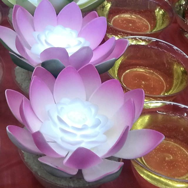Offerings of pink lotus and saffron water