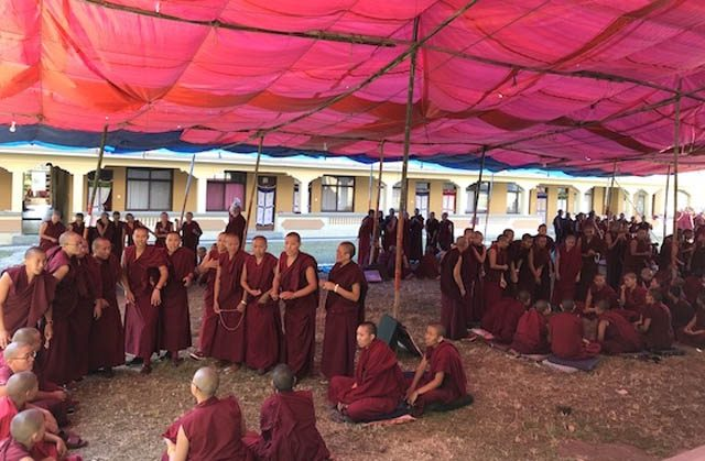 Nuns participating in the month-long inter-nunnery debate called the Jang Gonchoe, outdoors at Kopan Nunnery in Nepal