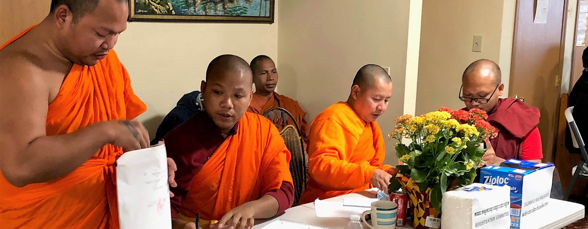 Monks from Seattle's Watt Dhammacakkaram overseeing voter registration, in the careful and transparent process the Cambodian sangha used to democratically elect a new board