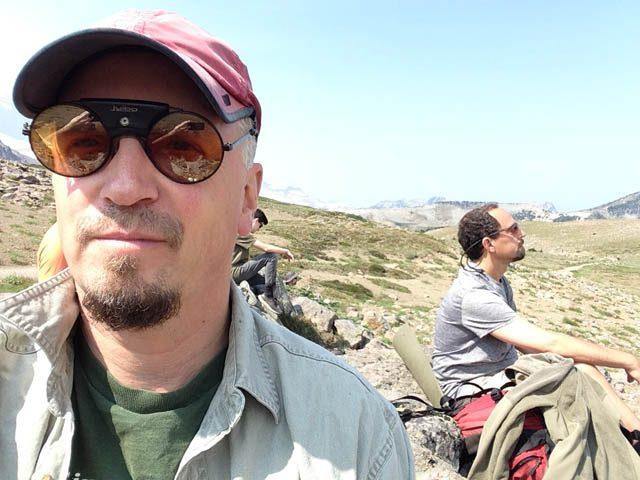 Mountain meditation hike Leader Ewan Magie (foreground), and friend Mayne Tabachnik, meditate near Berkeley Park on Mt. Rainier