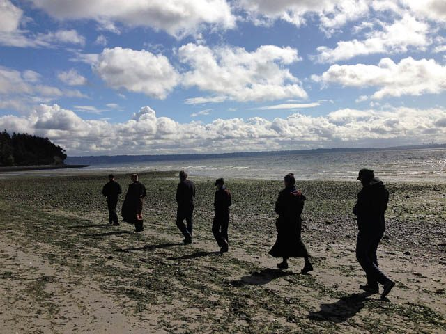 Magie and others do formal walking meditation, called Kinhin, during a fall sesshin at Camp Indianola on the shores of Puget Sound