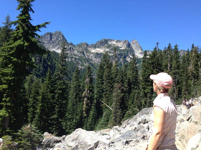 Johanna Hose gazes in silent awe at Cascade Range peaks, near Snoqualmie Pass