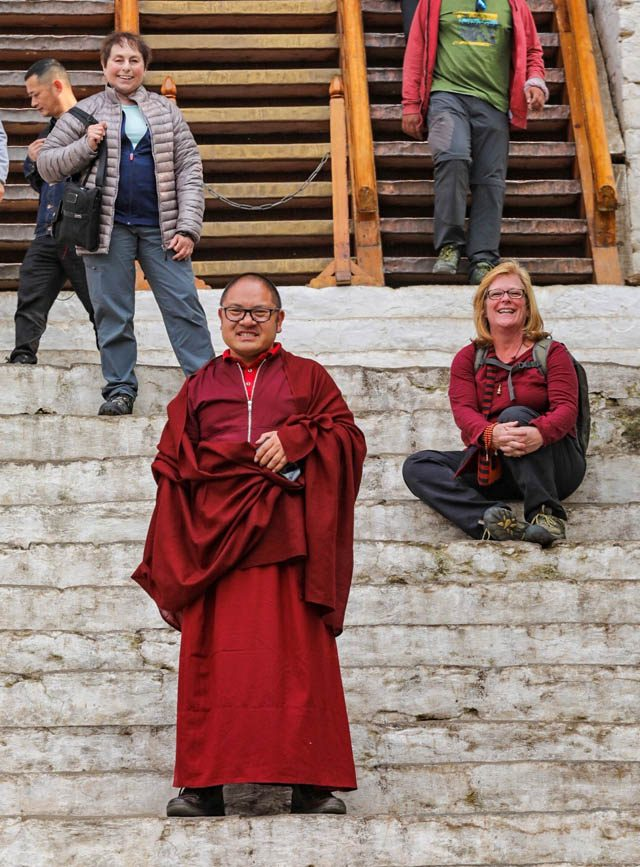 Adzom Gyalse Rinpoche in Bhutan with Jacqueline Mandell and Jeanne Enders in the background