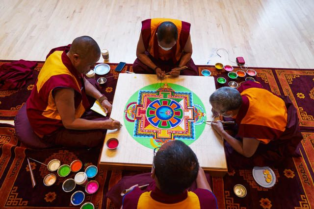 Four monks creating the sand mandala