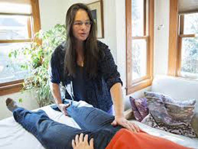 Cynthia Price, originator of the mindful body awareness training, working with a patient