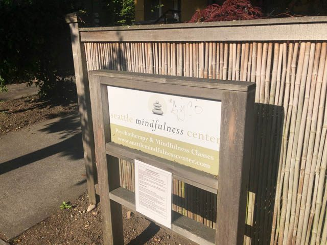 The Seattle Mindfulness' sign suggest the subtle balance we can attain through mindful contact with worldly events