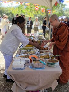 Ayya Cittananda at the midday meal offering at the recent October kathina celebration at Aloka Vihara Forest Monastery