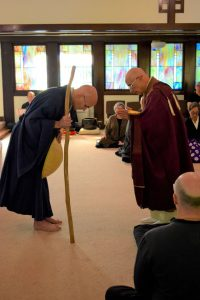 Having conferred the title of Dharma heir on Rinzan Pechovnik Osho — symbolized by the passing of the staff of teaching authority — Rinzan Osho bows in respect and appreciation to his teacher, Genjo Marinello Roshi