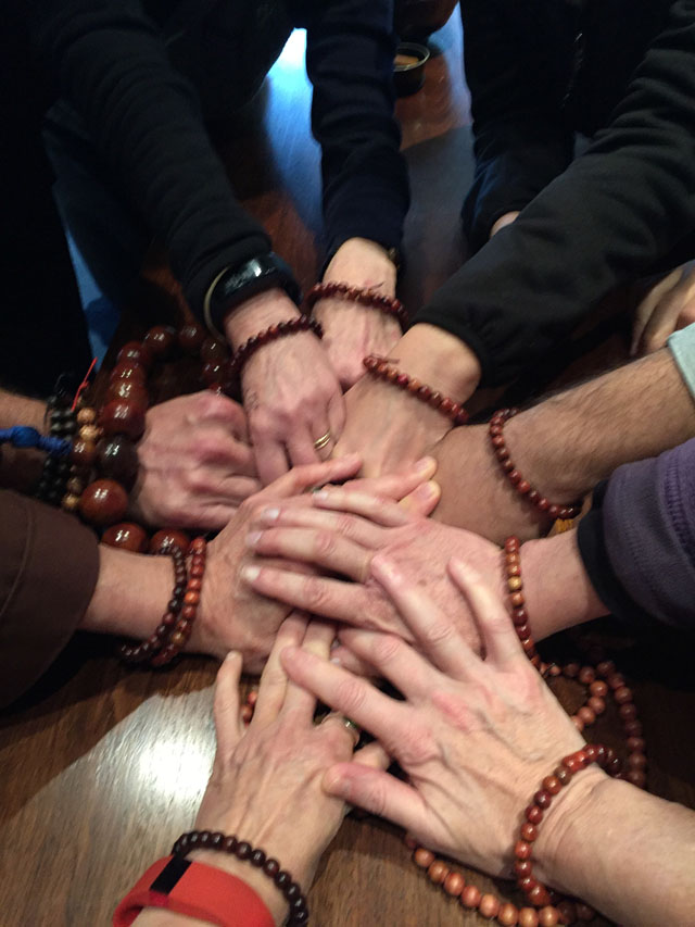"""People wearing malas celebrate a """"Listening to the Sound of Silence"""" retreat at the Trappist Abbey in Carlton, Oregon. The retreat was taught by Jerry Braza from the Order of InterBeing."""