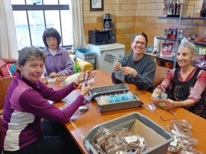 Volunteers at Tibetan Nuns Project sometimes pack malas made by Tibetan nuns in India, for online sale from Seattle. From left Deb Slivinsky, Shu-Hsiang Wang, Erika Bartlett, Iris Antman