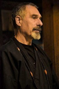 Jean-Luc Devis wears a beautiful mala given him by his wife Valerie Grigg Devis, following his taking-refuge ceremony at the Salem Zen Center.