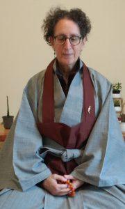 Zen Master Jeong Ji (Anita Feng) demonstrates mala use at the Blue Heron Zendo in Seattle