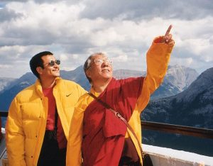 Khenpo Tsultrim Gyamtso Rinpoche points out a feature of the mountainous area, similar to Tibet