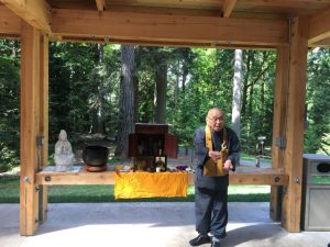 Hoitsu Suzuki Roshi invites attendees to offer incense at a memorial for Pellett at Priest Point Park in Olympia, Washington, in August