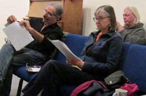 Sangha members John Ricca, Andi Salmi and Michael Kasten follow along with Tenzing's written handouts of poems